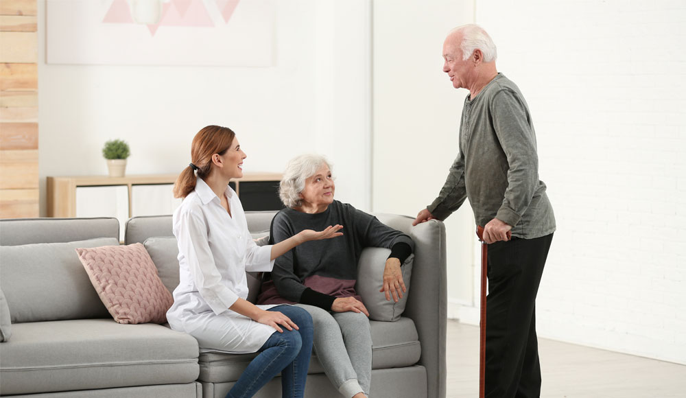 image of a lady and two elders talking