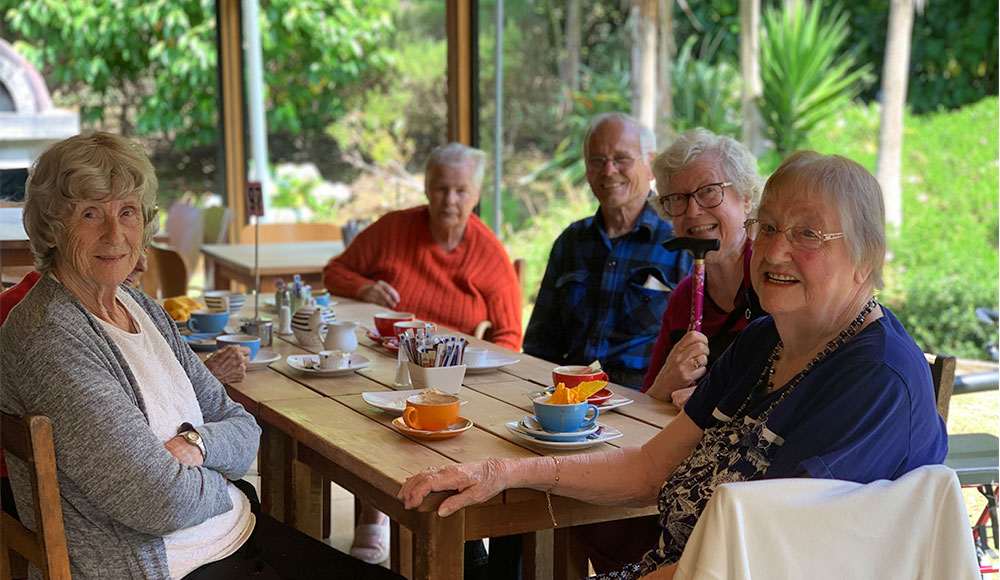 Photo of elderly having tea